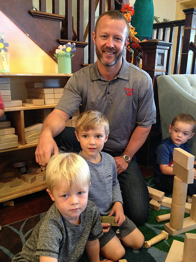 State Farm Agent John J. Harvell visits with Wintergreen preschool students (left to right) Isaiah Harvell, Casey Greenlaw, and Collin Robertson